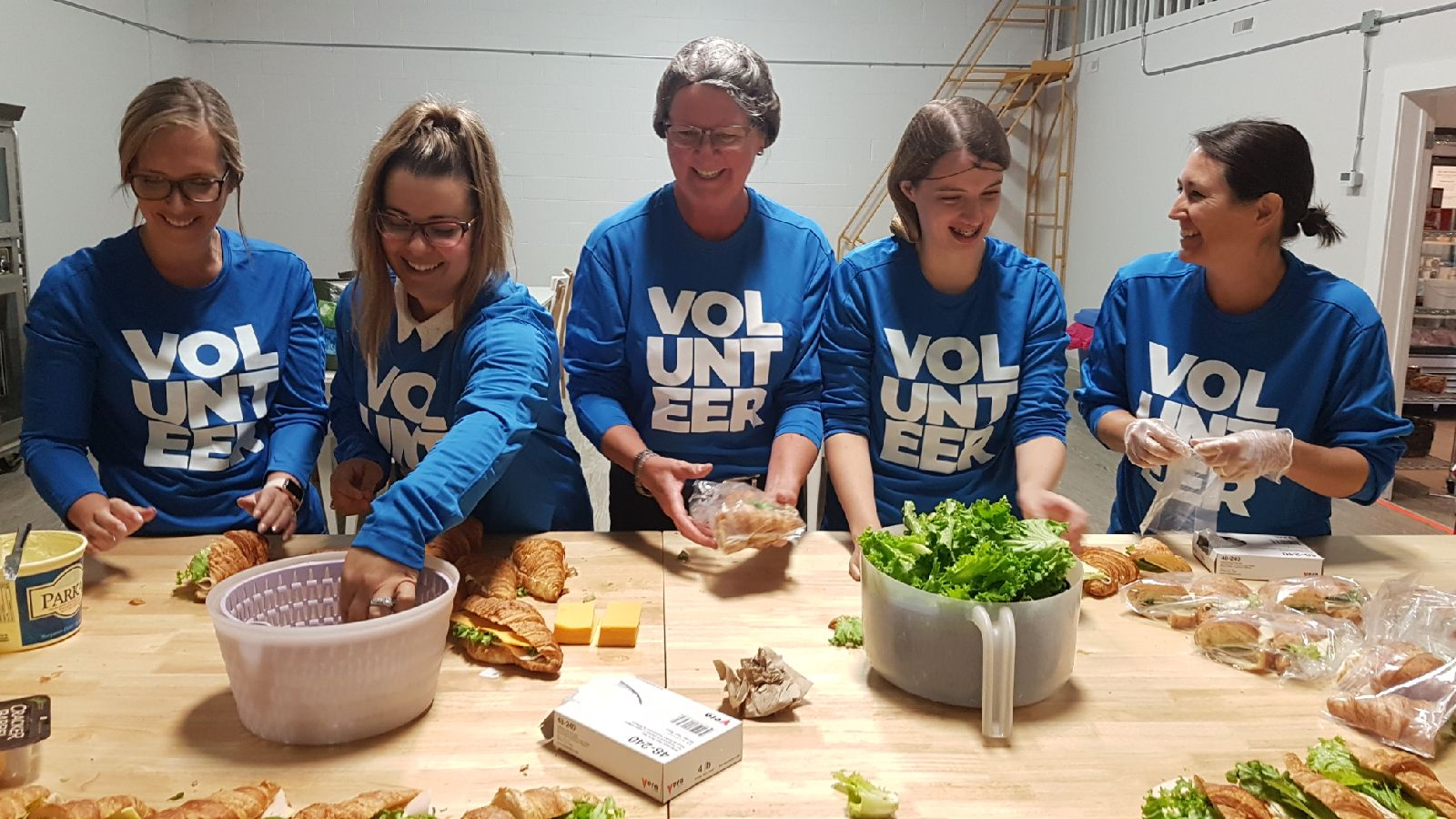 A team of Western Financial Group volunteers helps to build sandwiches for local not-for-profit Food for Thought