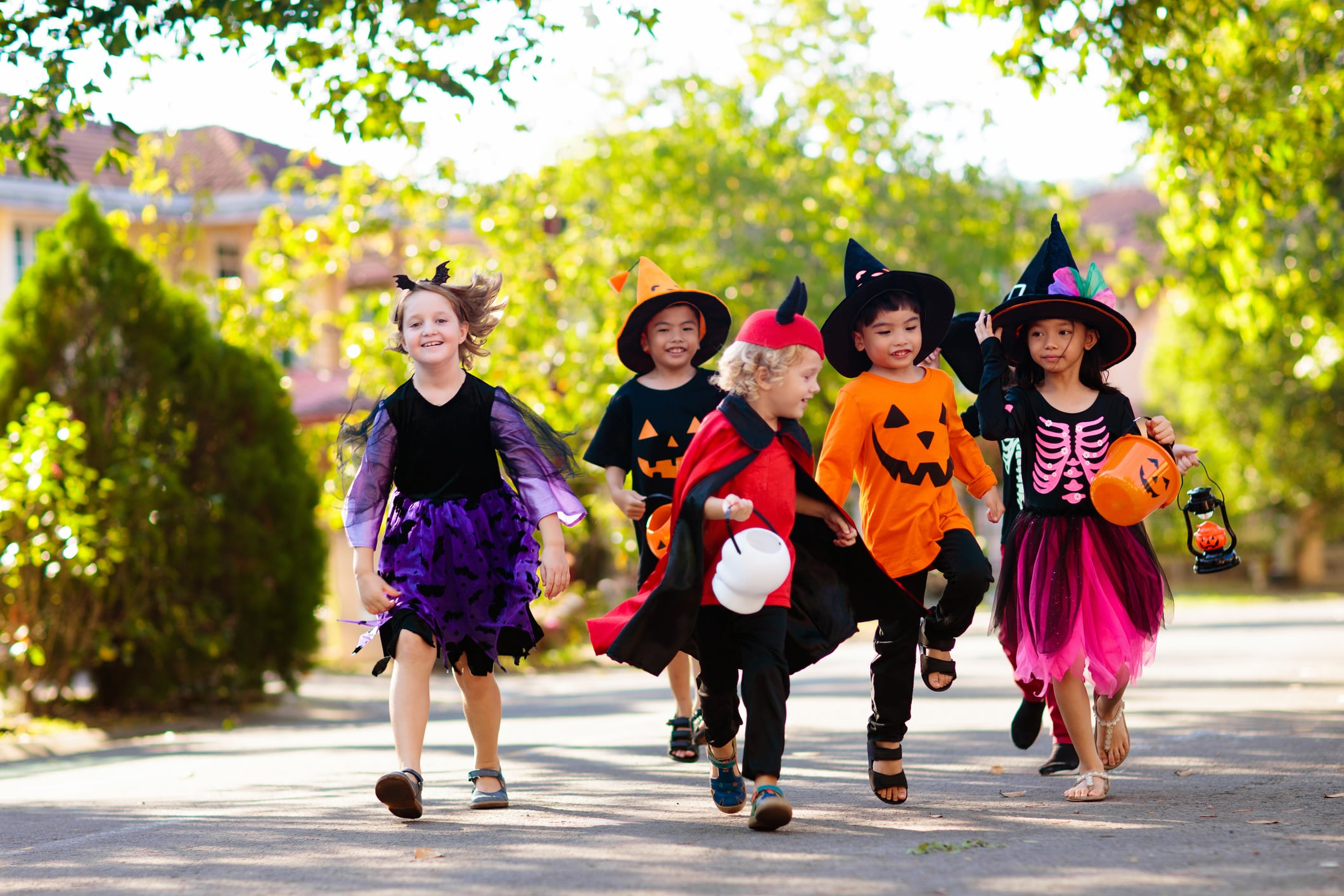A group of children dressed in Halloween costumes ready to go trick-or-treating