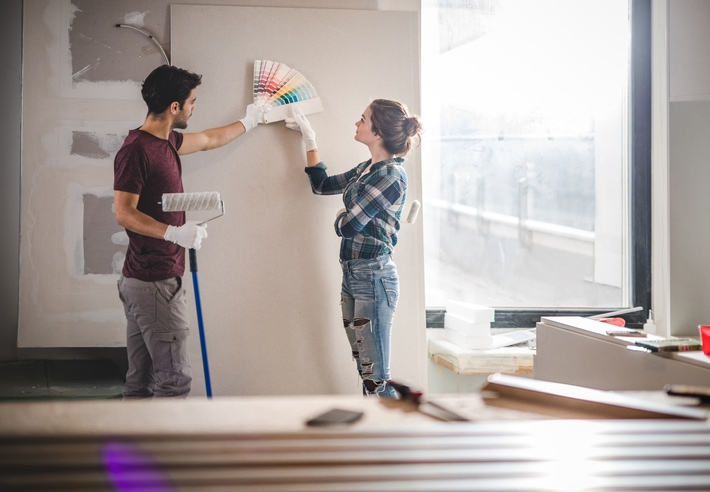 Young Couple Choosing Paint Colours For Their Renovations