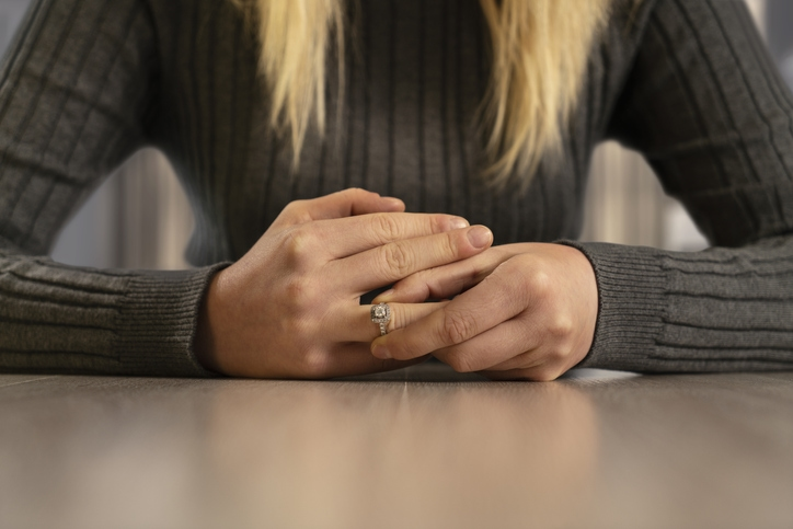 Young woman wearing an expensive ring on her finger