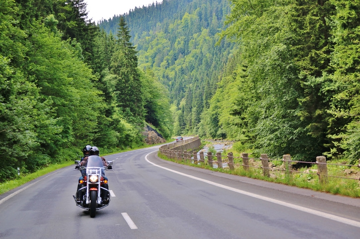 Motorcycle on forested mountain road