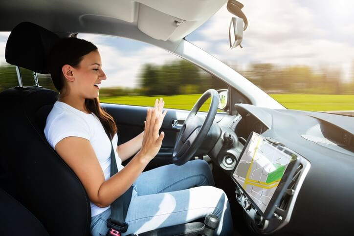 Young woman riding in a self driving car