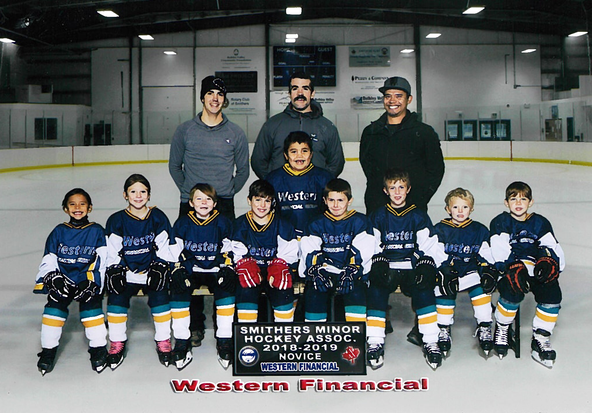The 2018/19 Smithers Minor Hockey Association novice team poses with coaching staff in the community rink