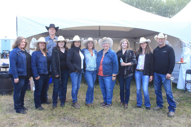 The Western Financial Group team in High River is joined by chuckwagon drivers Jordie Fike and Jason Glass during Guy Weadick Days 2019